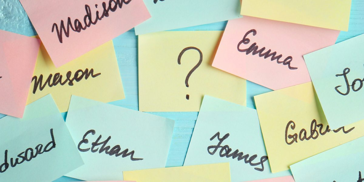 Choosing a baby name. Colorful post-its with possibilities.