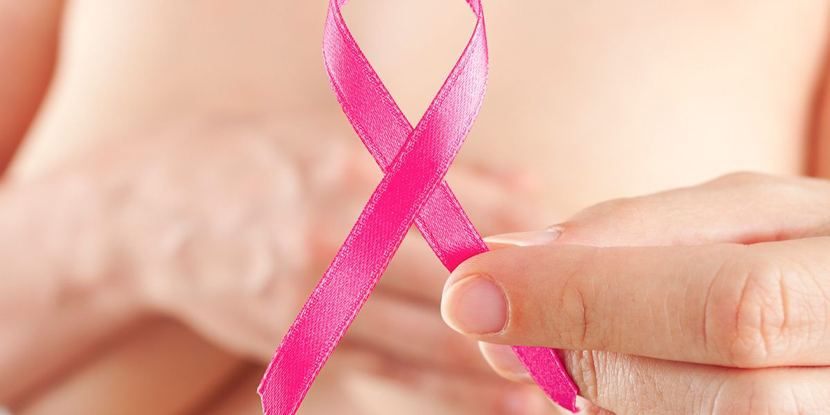 Woman holding pink ribbon.