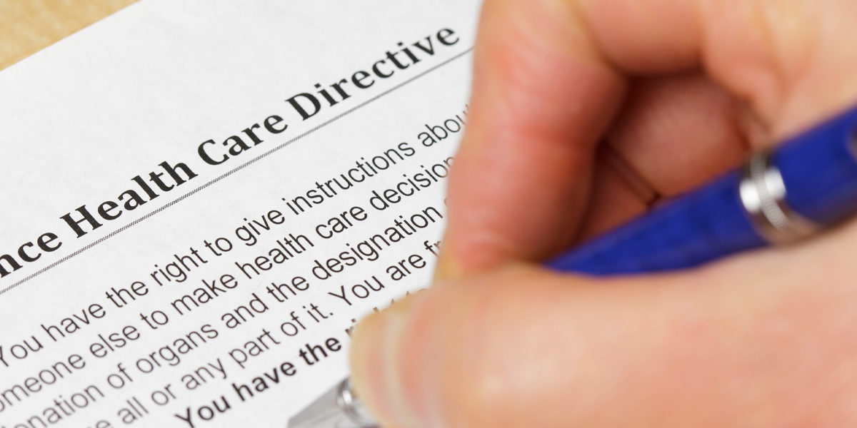 Image of individual filling out an advance care directive