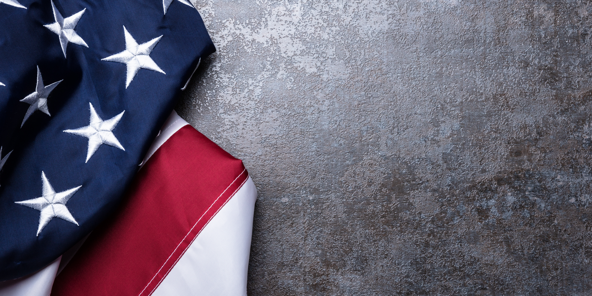 American flag with stars and stripes showing on flat surface