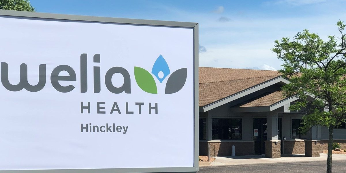 Building sign for Welia Health with building in background