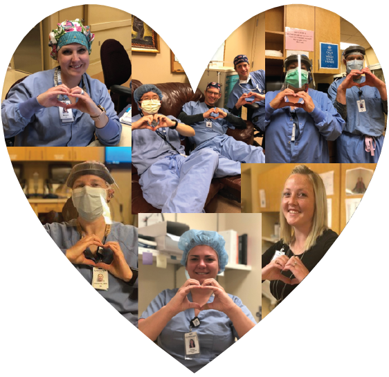 Surgery staff holding hand hearts in a heart shape.  Men and women wearing scrubs and personal protective equipment.