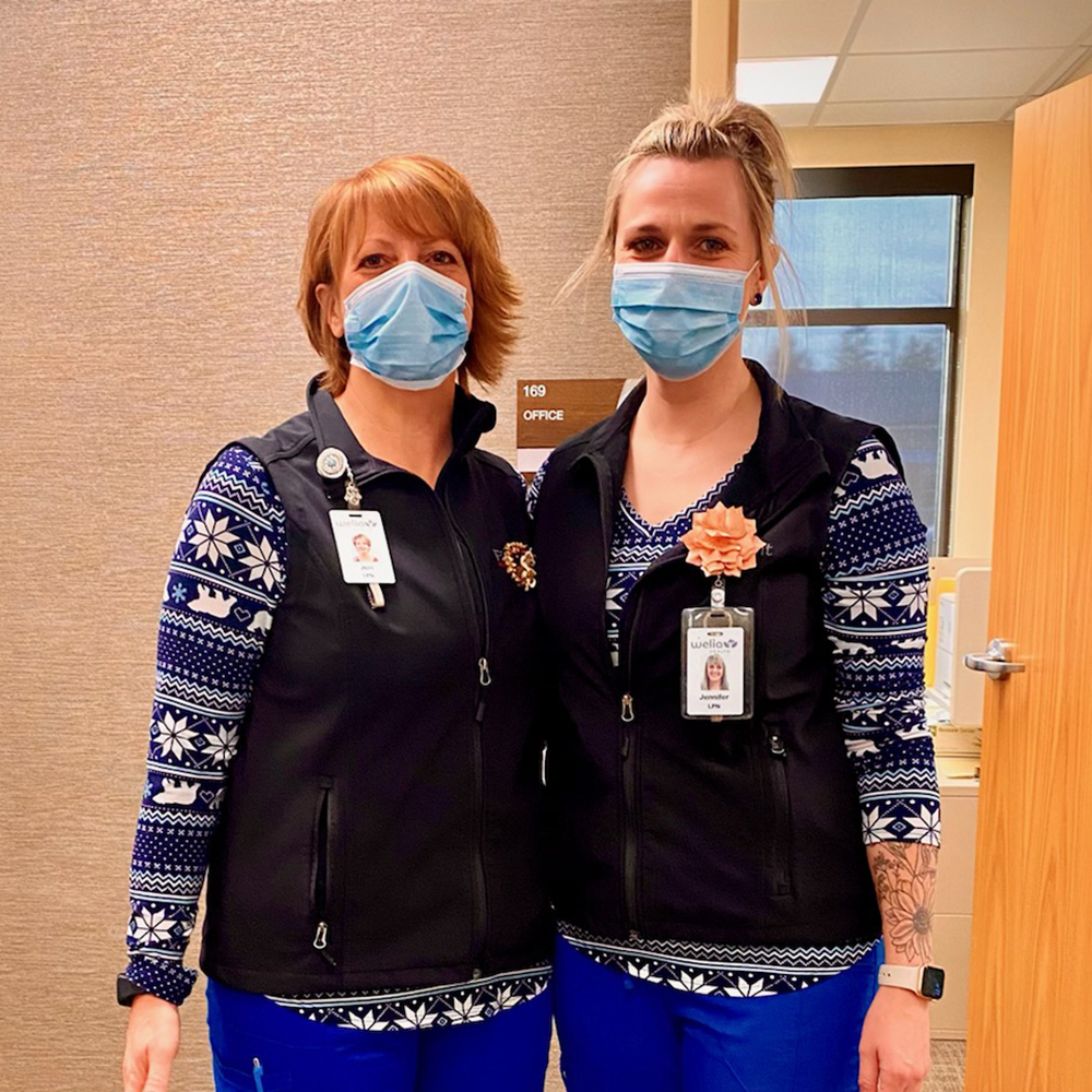 Two Welia Health staff members during the holidays