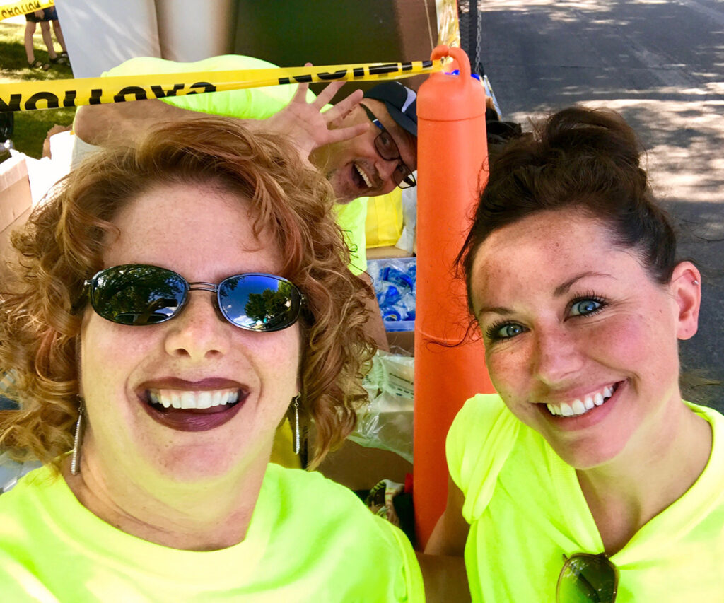 """Two Welia Health staffers being """"photobombed"""" by a third"""